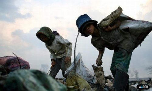 children diggin for food in landfill