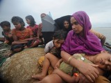 Rohingya in a boat seeking refuge