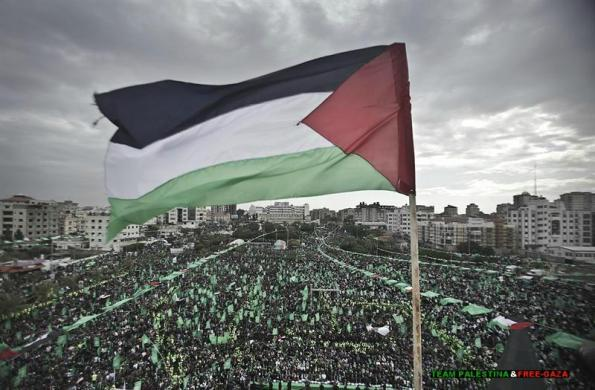 Palestinians attend the 25th anniversary of the creation of Hamas