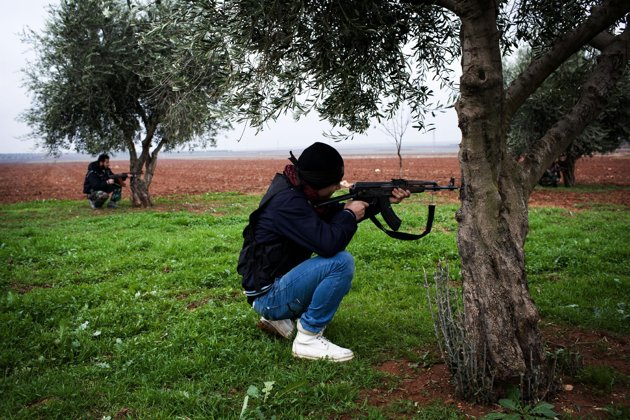 Associated Press/Manu Brabo - Free Syrian Army fighters aim their weapons, close to a military base, near Azaz, Syria, Monday, Dec. 10, 2012. The gains by rebel forces came as the European Union denounced the Syrian conflict, which activists say has killed more than 40,000 people. (AP Photo/Manu Brabo)