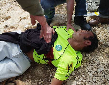 Bassam Abu Rahmah, who was killed within minutes of receiving a direct hit to the chest from an IDF-fired high-velocity tear gas cannister at a regular Friday anti-Wall demonstration on 17 April 2009.
