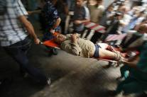 A male visible injured is carried by paramedics and security personal Gaza July 20 2014