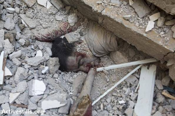 "Palestinian killed under the rubble of his home after an Israel missile targeted his home. ""The sleep, that never ends."" reads a post in facebook The death toll continues to rise in the East of Gaza as Palestinians retrieve their loved ones from the rubble. July 20, 2014 at Gaza, Palestine"