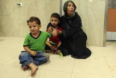 Eldery Palestinian women seen here with two children crying Gaza July 20 2014
