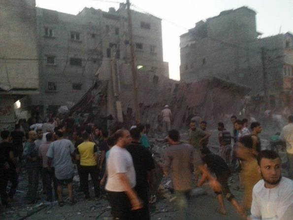 Apartment building flatten by Israeli missile in Gaza (photo/TV Networks)