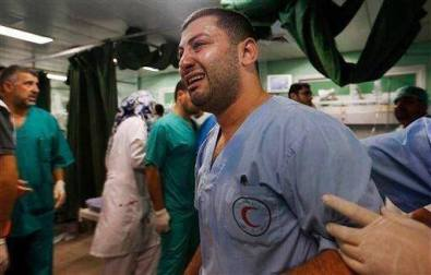 Palestinian paramedic falling apart at the sight of Israel attrocities committed to civilians