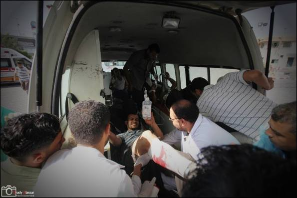 Patient being evacuated from Al-Qasar hospital after being hit by Israel tanks