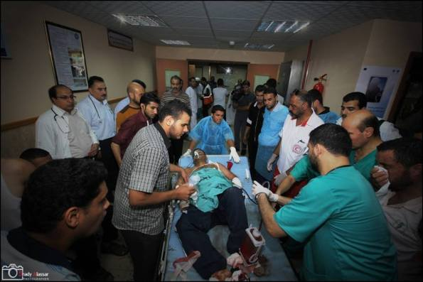 Patient being evacuated from Al-Qasar Hospital being shell by Israel tank shells