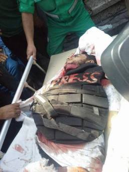 The body of Khaled Hamad the journalist killed during the assault in Sharaia neughborhood July 20 2014