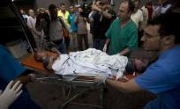 two boys being rushed to an ambulance injured in the assault of Gaza July 20 2014