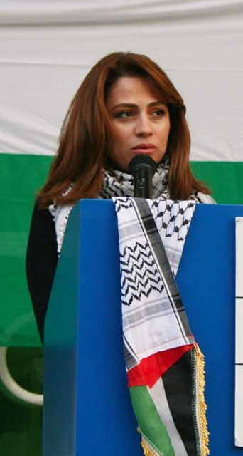 Julia Boutros speaking at the American University in Dubai for an event to raise funds for Gaza