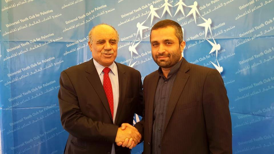 Palestinian ambassador to Tunis, Salman Al Harfi greets Reza Barekati, the Iranian representative for  Universal Youth Club for Palestine greets Palestinian at Al Manar University during the World Social Forum 2015