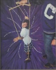 "Domestic Violence a Personal Journey. ""The Puppet"" A photo of a photo at Orange Coast College Gallery, on April 15, 2015. Costa Mesa Cali. Photo/Marivel Guzman"
