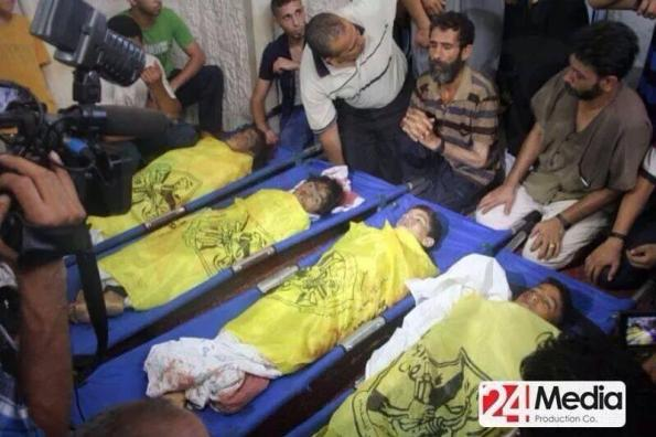 The bodies of the four children Mohammed Baker, 9-year-old; Ahed Baker, 10-year-old; Zakaria Baker, 10year-old; and Mohammed Baker, 11-year-old, are seen here being mourn by his male relatives.