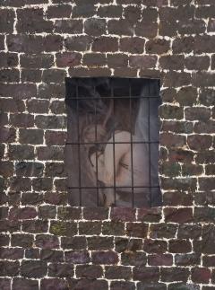 "Domestic Violence a Personal Journey. ""The Prisoner"" A photo of a photo at Orange Coast College Gallery, on April 15, 2015. Costa Mesa Cali. Photo/Marivel Guzman"