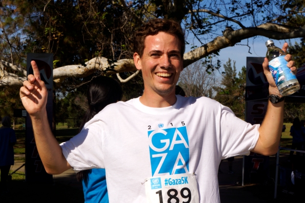 Nick Locke, 19-year-old, from University California San Diego, and member of Students for Global health, first place at the moment to enter the finishing line at the Gaza5k Orange County/LA Race, at Mile Square Park on October 24, 2-15, donation drive for Mental Health Programs in Gaza, Palestine, sponsored by UNRAWAUSA, with the participation of the Palestinian suppoters community, at at Fountain Valley, Calif photo/Marivel Guzman